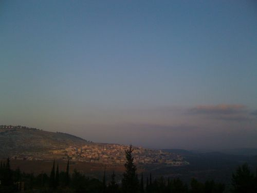 Israel: Sun rises on the Arab village of Shaab (as seen from the Jewish village of Shorashim)